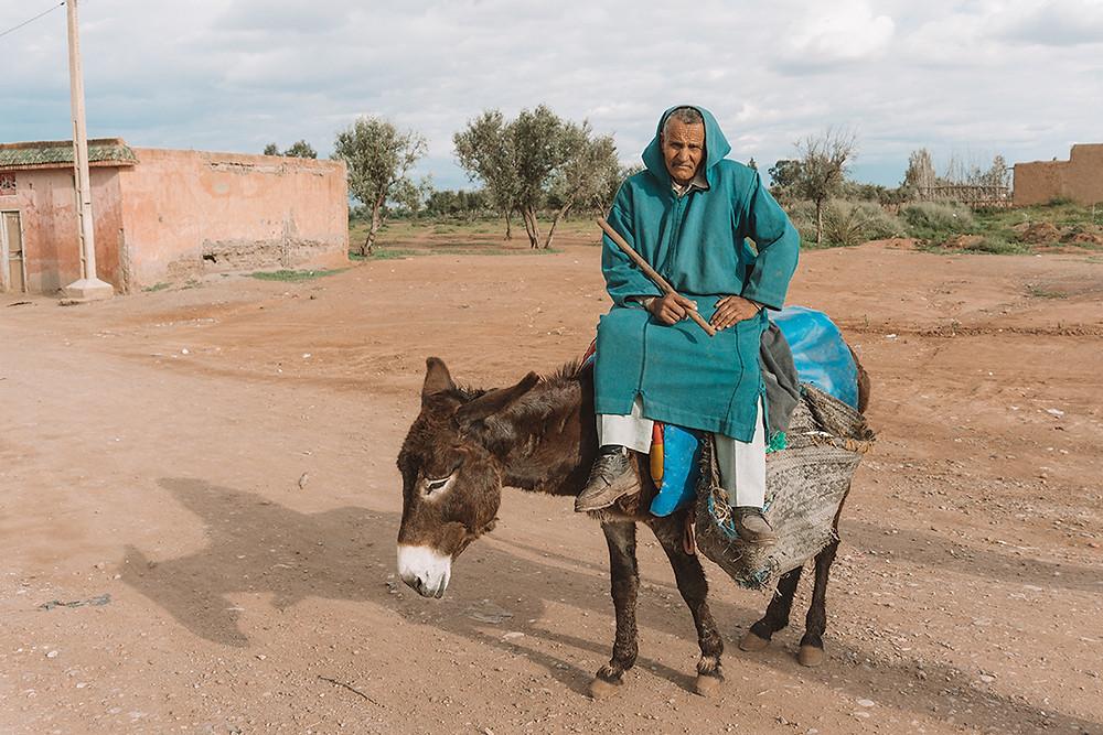 Moroccan Berber sat on donkey wearing robe