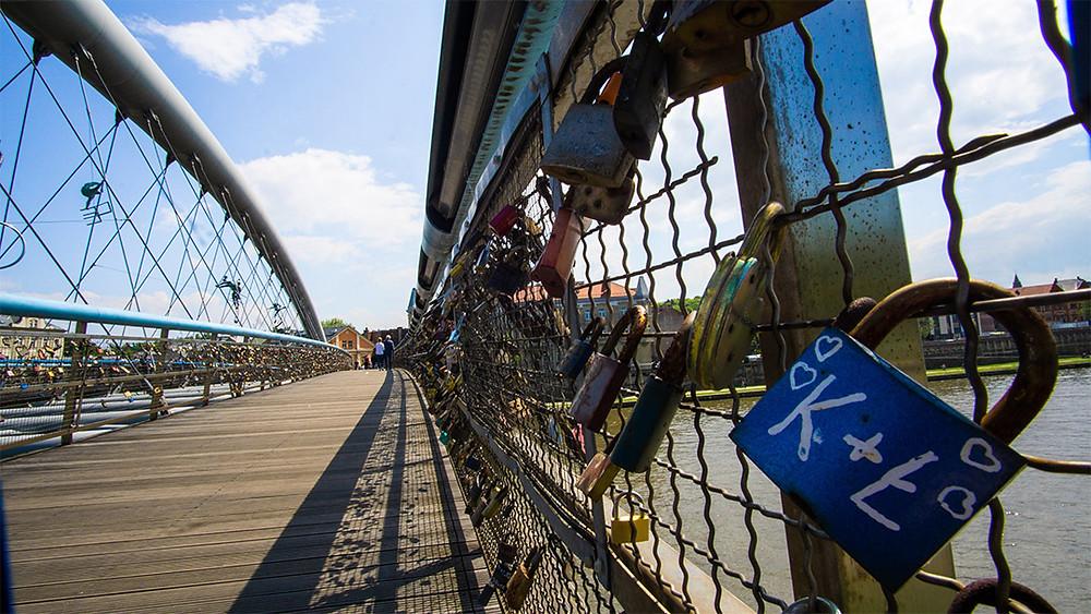 Padlocks on wooden and steel bridge in krakow