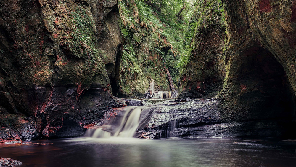 waterfall in the caverns with fern plants