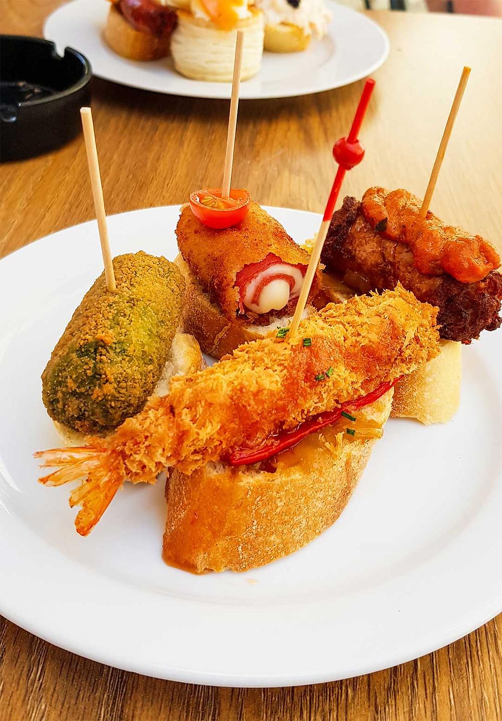 Pinchos or Pintxos in Barcelona Food on a Stick