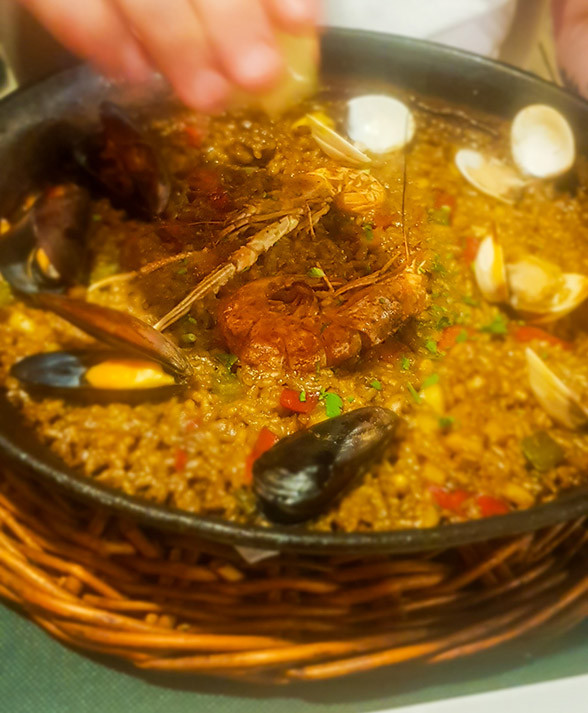 Traditional Paella with muscles, clams and shrimp