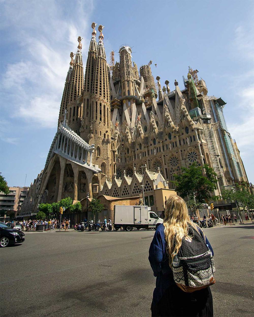 Girl looking at Sagrada Familia in Barcelona
