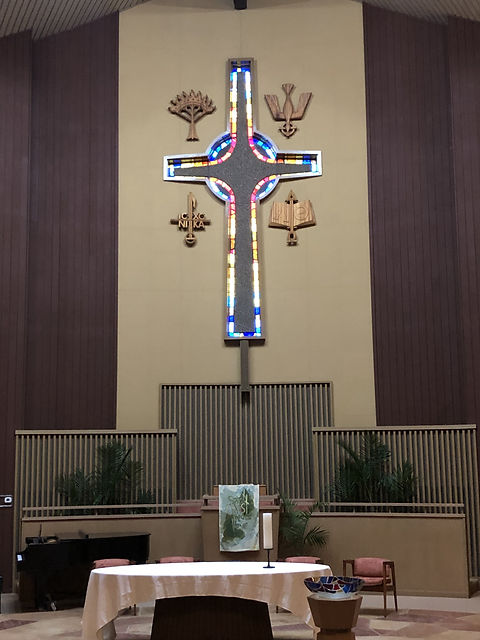 Covenant's communion table, pulpit, and cross, with palms