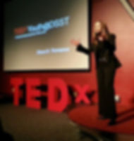Diana Brittain Thompson speaking on the Tedx Stage