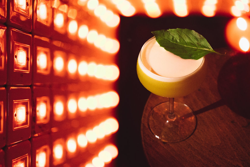 double exposure of a cocktail and lights