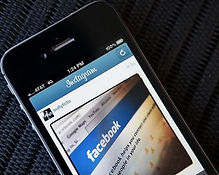 Cellphone showing Facebook logo. ICU Investigations. Private investigator near me.