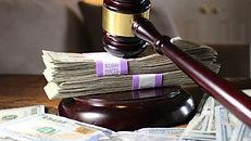 Court gavel over pile of cash. ICU Investigations. Private investigator near me.
