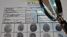 Magnifying glass and fingerprints. Skip Locate Tracing. Private investigator near me.