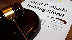 Paper with child custody investigations written on it next to a gavel. Private investigator near me.