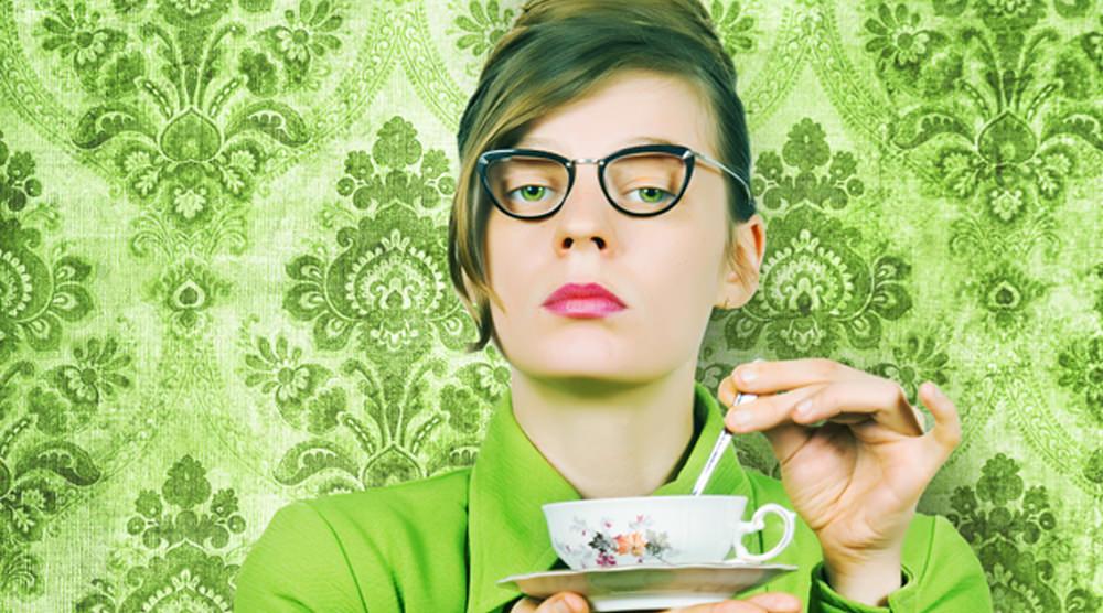Woman wearing green. Private investigator.