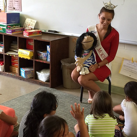 Guinevere Davenport with her puppy Gloria teaching children at  Kahakai Elm school  about the danger of bullying. Photo courtesy of Guinevere Davenport.
