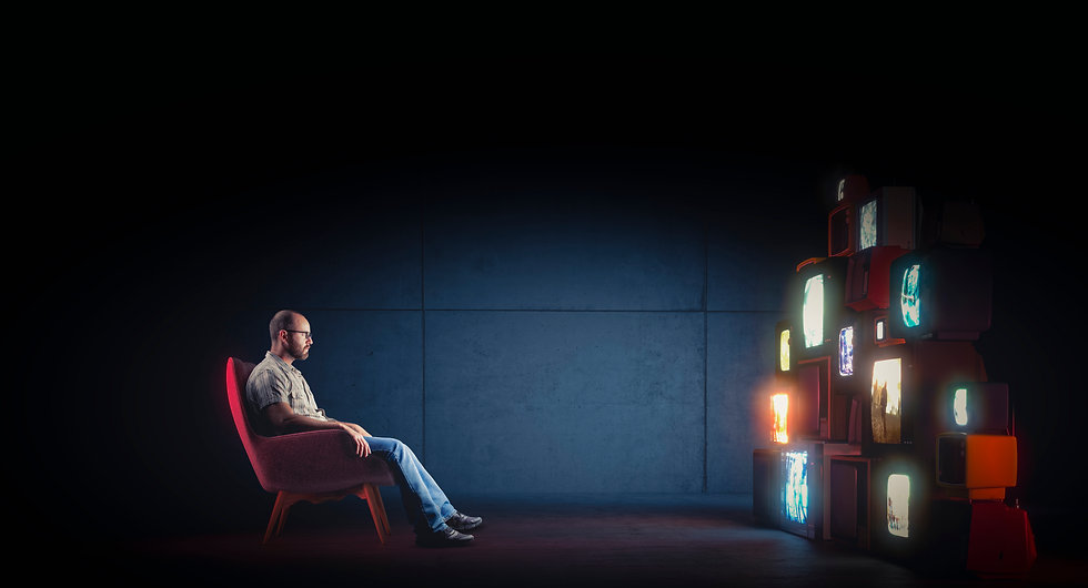 caucasian-man-with-glasses-sitting-armchair-watching-several-vintage-televisions.jpg