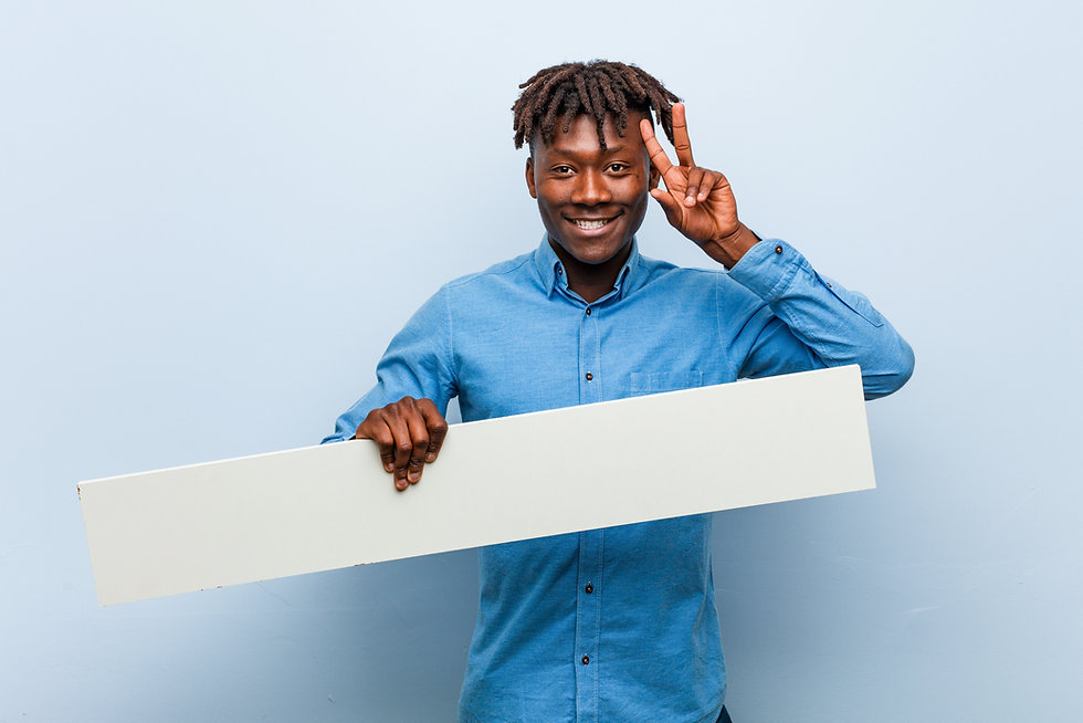 young-rasta-black-man-holding-placard-showing-victory-sign-smiling-broadly.jpg