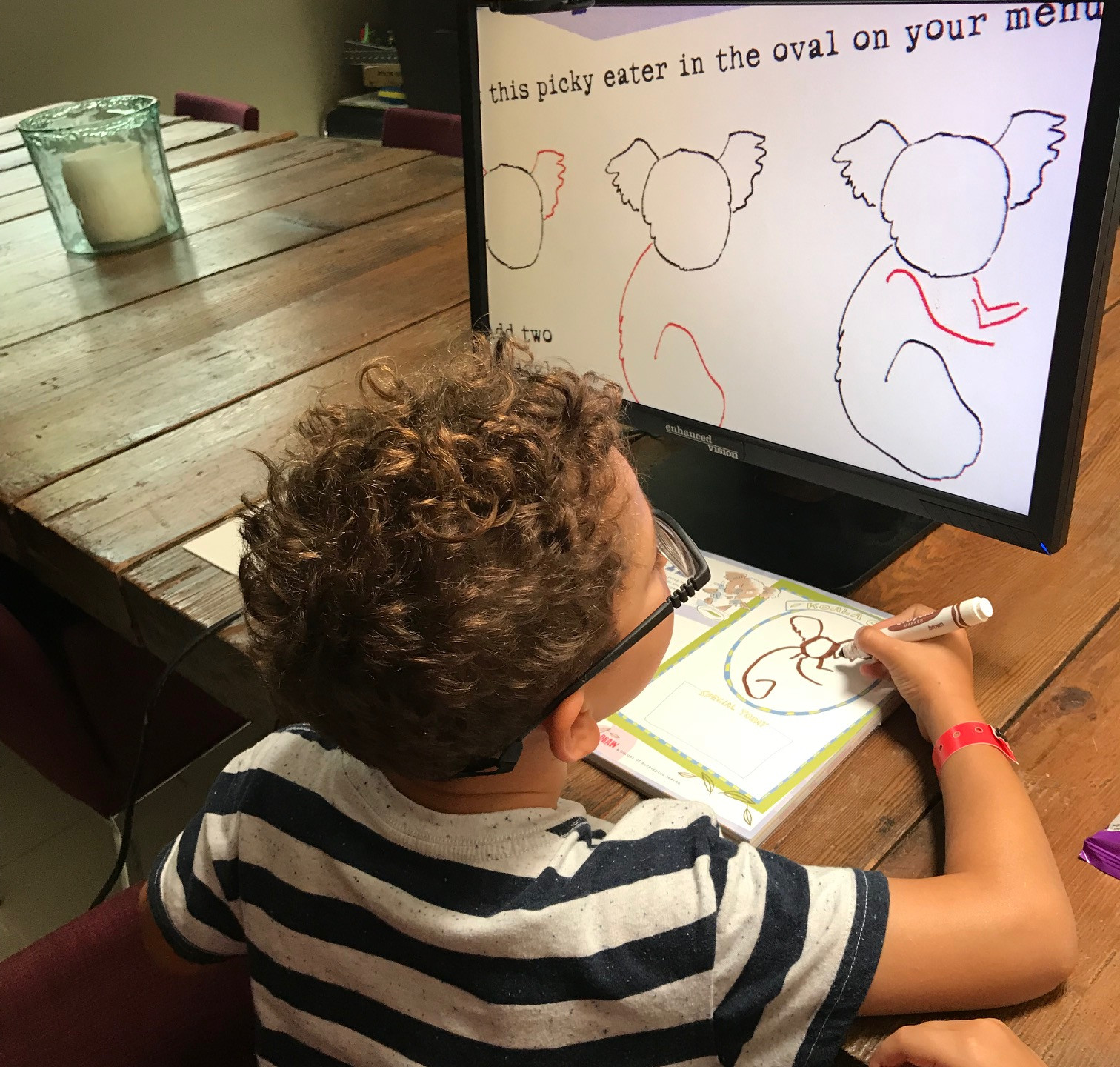 Santiago writing with Acrobat