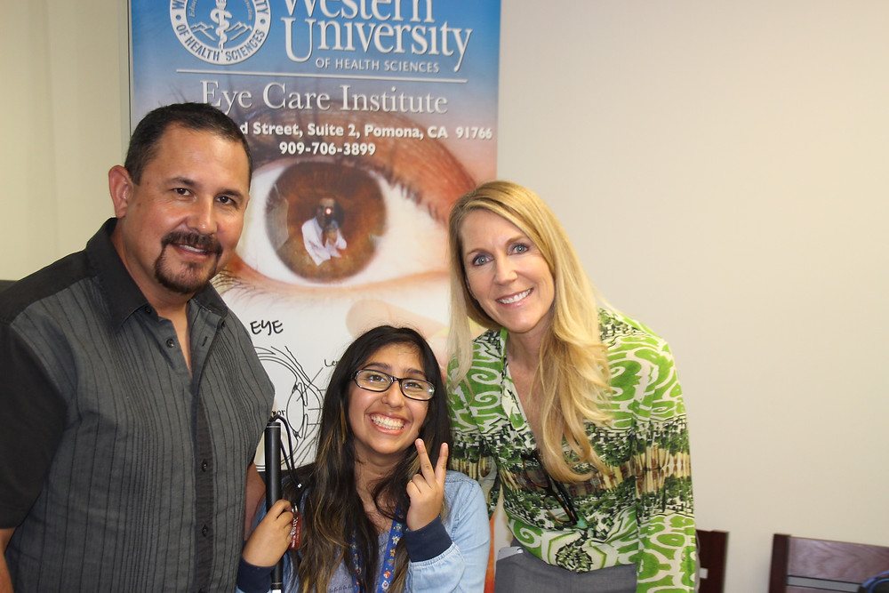 Emily Rubalcava with her father Israel and Tori Schladen.  Emily's family has been receiving services from Partners for Pediatric Vision since 2015, when Emily's vision began to decrease.  She is an outstanding student and uses low vision technology and Braille to achieve academic success.