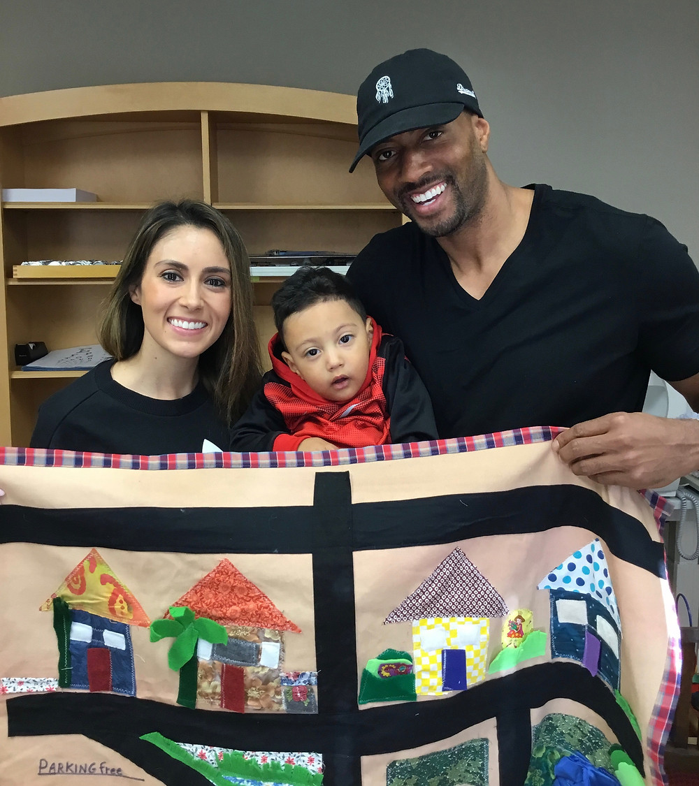 """""""Thank you to the Binky Patrol and Judith and Jane.  Kayden loves his special play mat!"""" Bernice, Kayden and Keenan"""