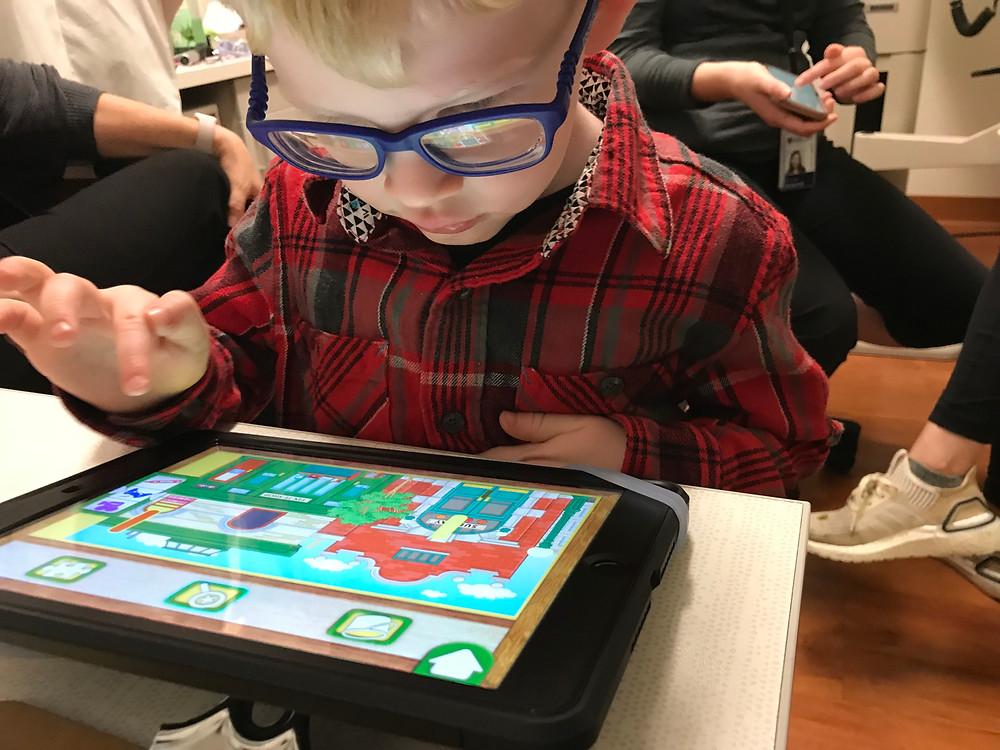 Ben using high contrast app on the iPad