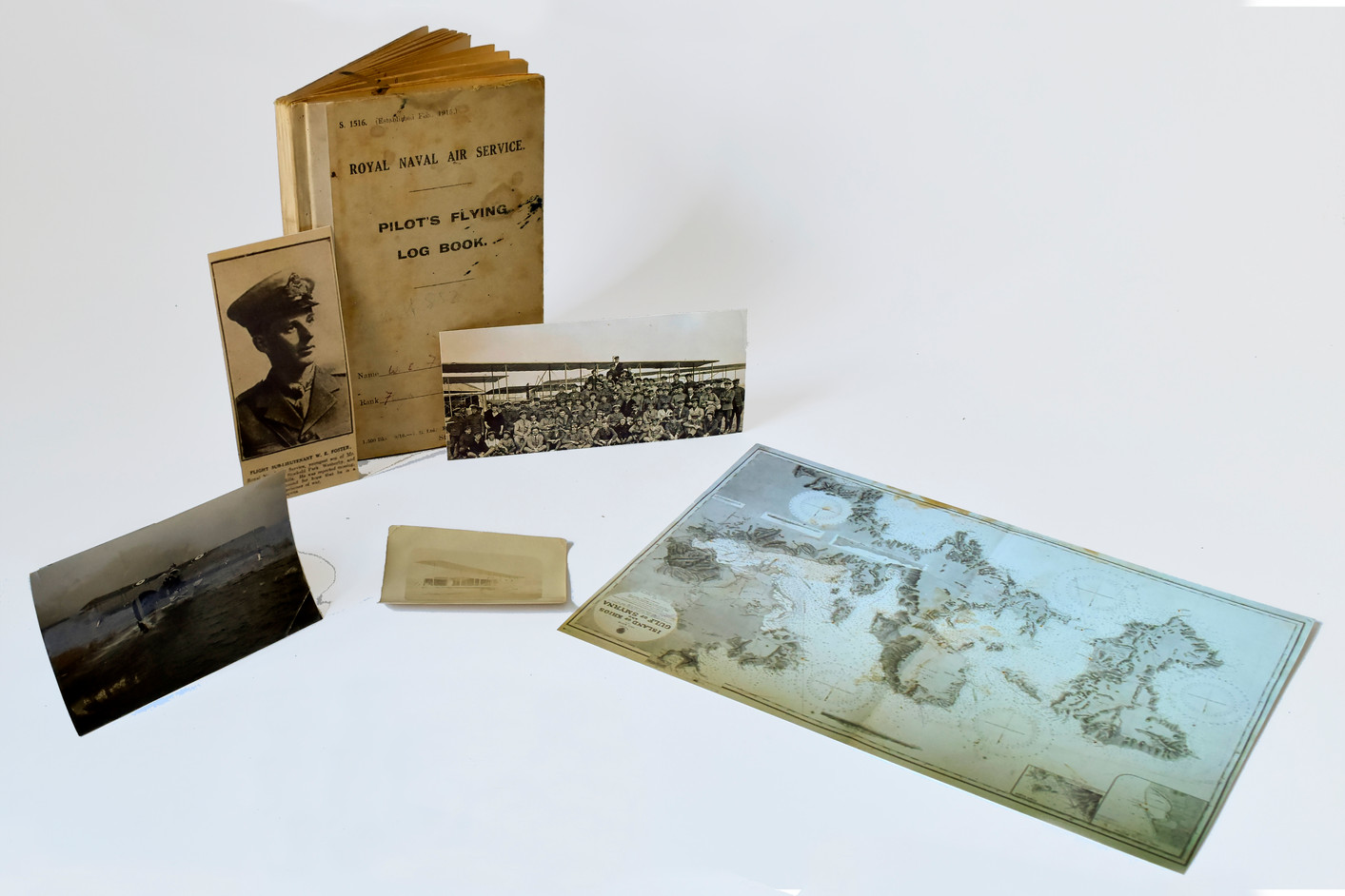 Foster's log book and photographs