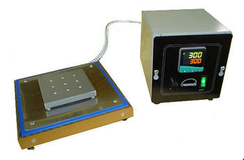 (Above) Special hot plate with a 4 in square heated surface drilled and tapped to customer specifications. This hot plate is controlled with a programmable digital thermostat.