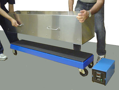 (Above) Custom hot plate with a 10 x 54-inch coated surface, mounted on casters, with a removable insulated hood. Temperature is controlled with a remote digital thermostat.