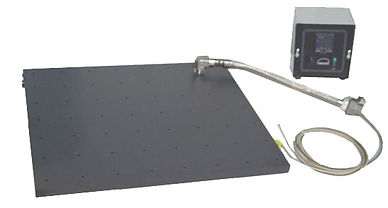 (Above) This 18x18 inch low profile hot plate was custom made to fit in a special glove box. The plate is perforated with small through-holes on one-inch centers. These holes allow drainage from a soaked, flexible fabric placed on the top of the plate and heated to 100C. Temperature is accurately controlled with a digital thermostat located outside the chamber.