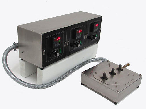 "(Below) Custom multi-zone hot plate has 3 hot surfaces (.5 x.5 in), each controlled with a digital thermostat. One of the zones includes a vacuum which is used to ""pull down"" a small component to the heated surface."