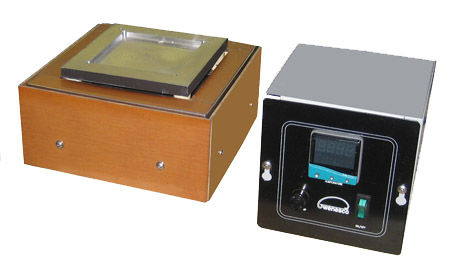 (Below) Electrically-isolated hot plate Model HPI66 has a 6X6 inch aluminum heating surface that is rated at 1000V. The plate in this photo has been custom machined to fit a special work-piece to be heated.  Temperature is controlled with an accurate  remote digital thermostat with PID function. Set point and current temperature are digitally displayed. Model HPI66 operates at your choice of 120 or 240VAC, with a temperature rating of 400C Larger models are made to order.