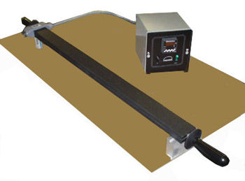 (Above/Right) Model HAN 2402 double-sided, Teflon-coated hot plate for butt-fusion welding of polyethylene sheets. This 24 x 1.5 in. plate is controlled with an accurate, remote digital thermostat, with an adjustable range of 70-400F, with heat evenly distributed across all surfaces of the plate. Supported at both ends with insulated handles, it may be mounted to a work table as shown.