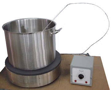 Model HP18S16 Hot Plate shown with a 5-gallon. stock pot.  Note that the thermocouple from the remote thermostat is immersed in the pot so that the hot plate is controlled using the temperature of the fluid rather than the plate surface