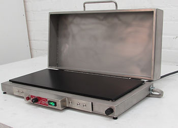 (Left) Model HP818MH with 8 x 18 in anodized aluminum plate features an attached stainless steel cover, which swings out of the way when the hot plate is not being used. The overall dimensions are 20x10x4 inches with the cover closed. This hot plate operates at 120V, and is controlled with a built-in analog thermostat. The temperature range is 70 to 550F.