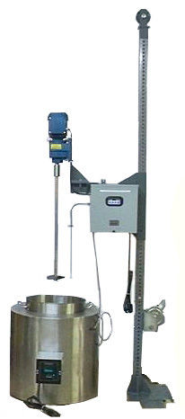 (Left) Wenesco's 10-gallon Multi-Melter is combined with a winch to lower a stirrer into the melted compound. The Multi-Melter features quick interchangeable liners, which contain different compounds. Temperature is controlled with an accurate digital thermostat. The stirrer speed is managed with a variable frequency drive. The thermocouple, measuring the melt temperature, is also raised and lowered into the melted compound.