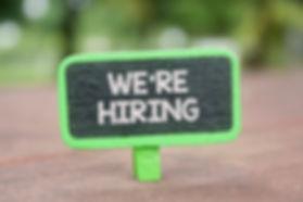 Wooden clip written we're hiring over bl