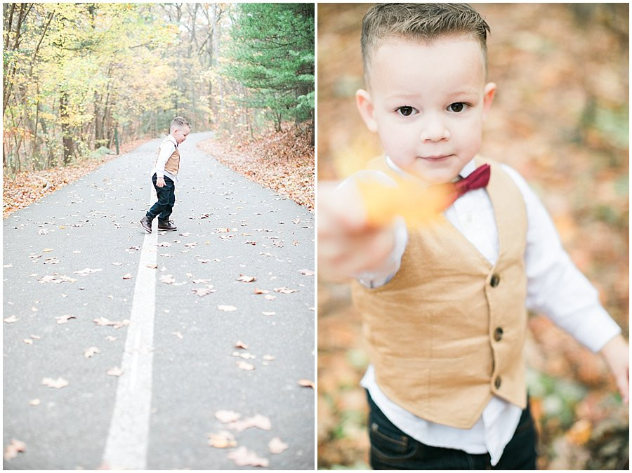 3 year old boy Jacob, looking for the perfect fall foliage leaf to give to photographer