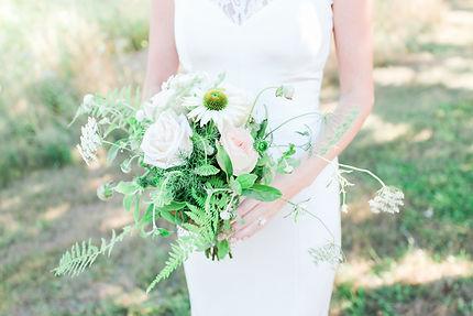 Bride holding Wildflower bouquet