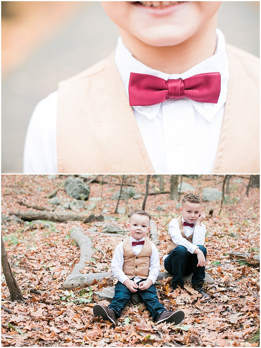 A close up of a boy's maroon bow tie, brothers Johnny and Jacob photo session in the woods
