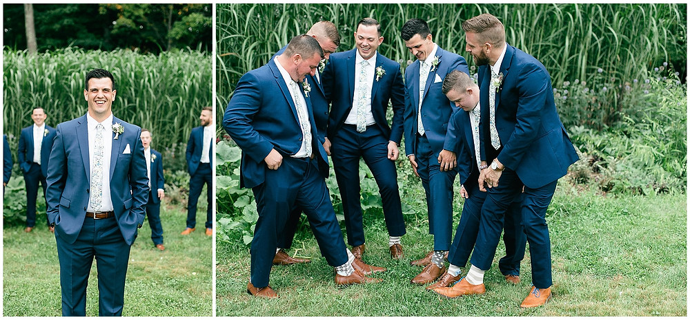 Groom and his groomsmen showing off their socks during getting ready photos.