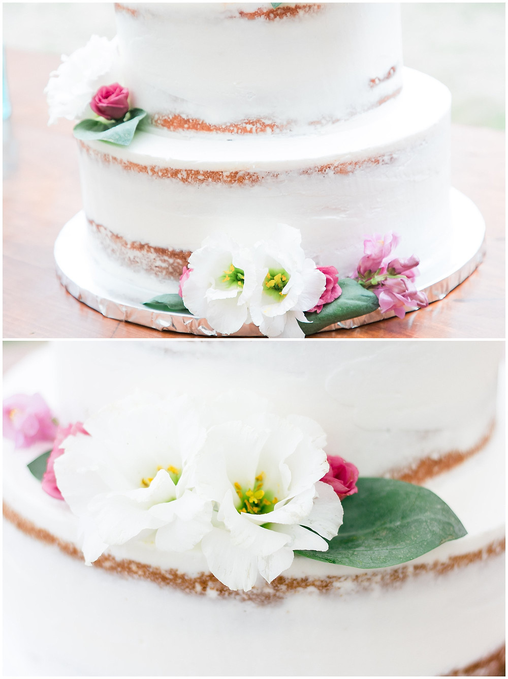 Tiny details of the naked wedding cake with flowers on each layer.