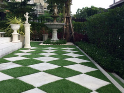 Walkway around home by artificial grass
