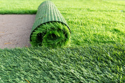 Green artificial grass soccer field