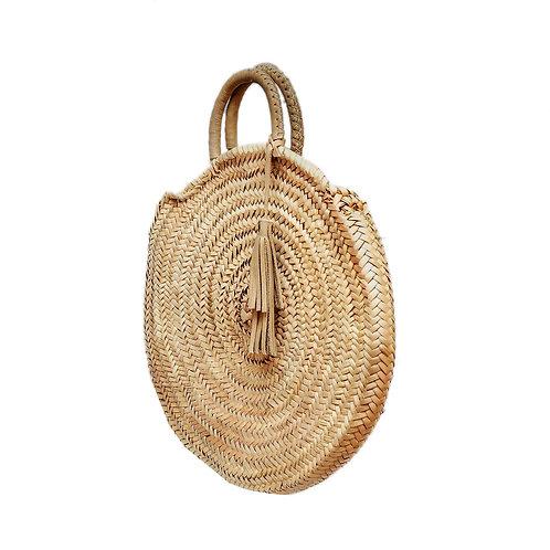 sac rond naturelle avec mains