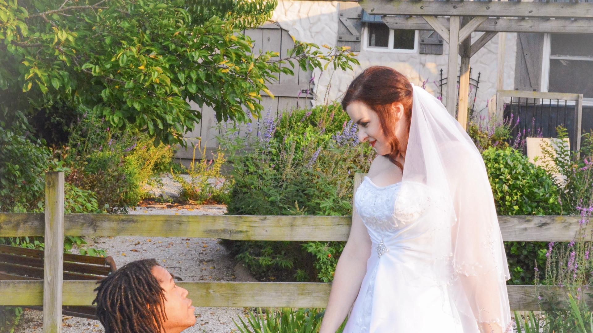 11-Groom kneeling Bride standing cottage