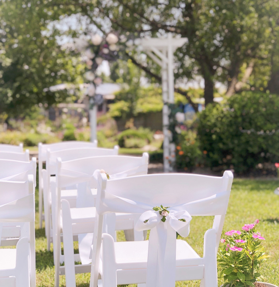 16-White chairs with bow.jpg