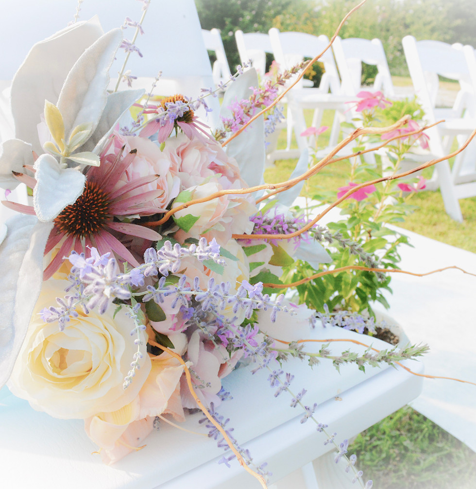 4-Bouquet on white chairs.jpg