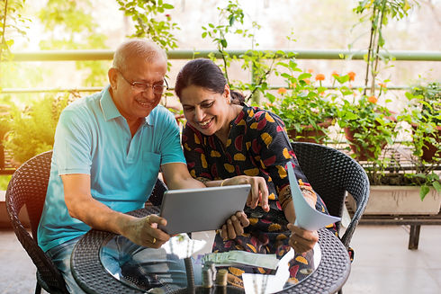 Senior Indian/asian couple accounting, d