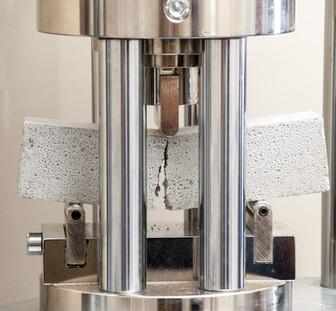 Measurement of strength on mortar sample.