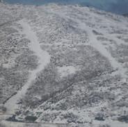 Snowy Mountains Backcountry SMBC - Guthega Resort: Parachute & Woodpecker runs. SMBC HQ at bottom