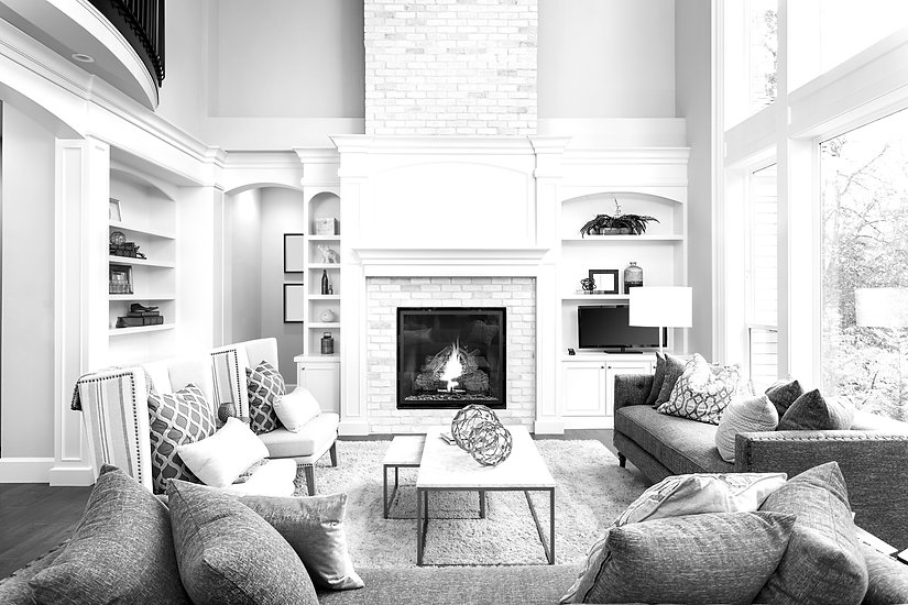 Beautiful living room interior with hardwood floors and fireplace in new luxury home_edited_edited.j
