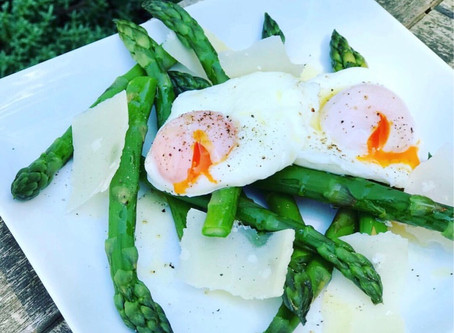 Asparagus & poached eggs with Parmesan shavings and truffle oil.