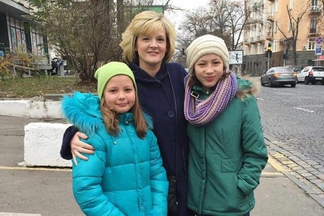 Michele Donnelly in Ukraine visiting her adopted children