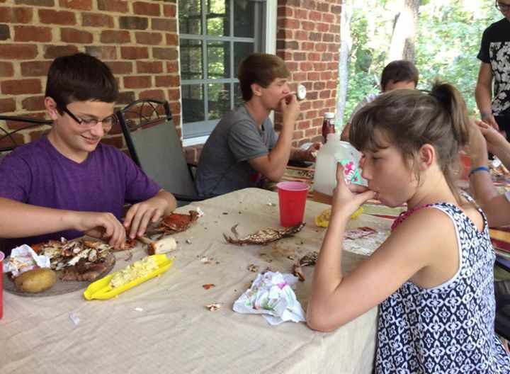 Donnelly family tribe eating crabs together